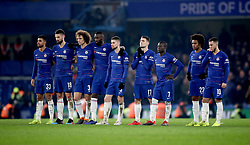 Chelsea players stand watching the penalty shootout during the Carabao Cup Semi Final, second leg match at Stamford Bridge, London.