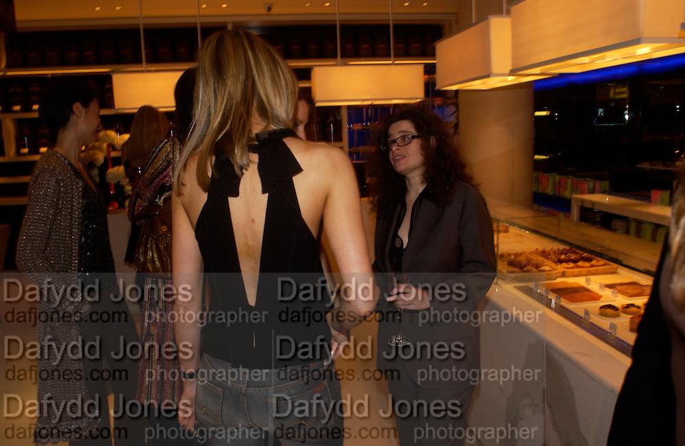 Kim Hersov and Amanda Sharp, 2004 Frieze Art Fair curatorial programme Cartier dinner. Yauacha, Broadwick St. 13 October 2004. ONE TIME USE ONLY - DO NOT ARCHIVE  © Copyright Photograph by Dafydd Jones 66 Stockwell Park Rd. London SW9 0DA Tel 020 7733 0108 www.dafjones.com