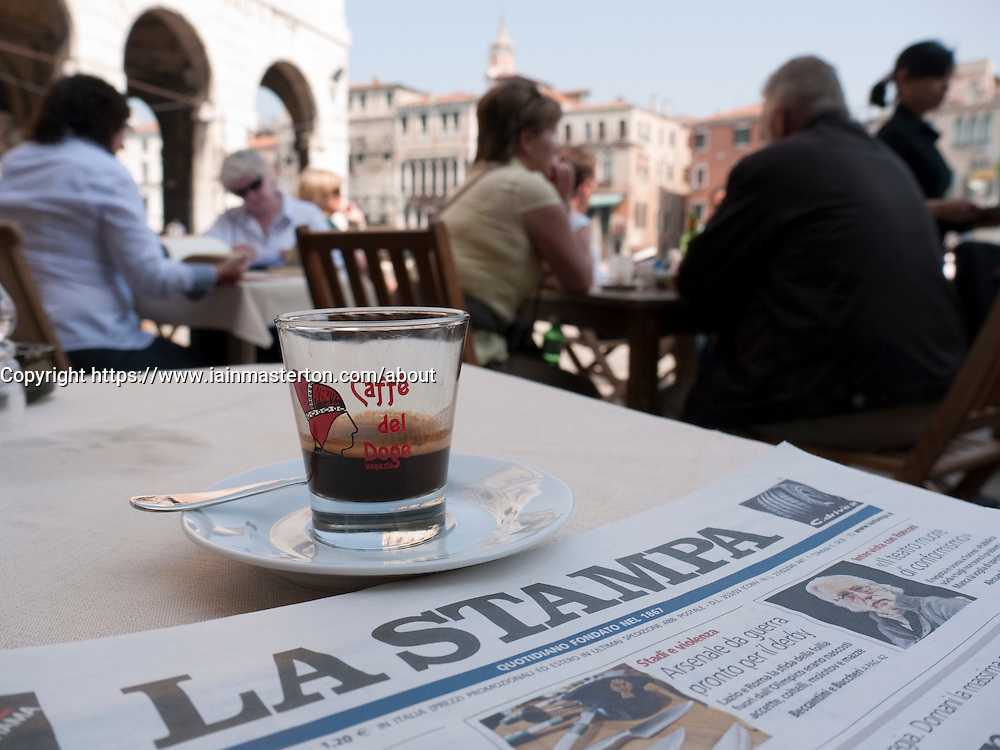 Detail of Italian newspaper and coffee at typical cafe in Venice Italy