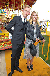 LAURENCE FOX and BILLIE PIPER at the 2012 Veuve Clicquot Gold Cup Final at Cowdray Park, Midhurst, West Sussex on 15th July 2012.