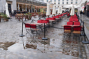 Empty seating awaits bar and restaurant customers on a wet and rainy day in Covent Garden during the second wave of the Coronavirus pandemic and when the capital is designated by the government as a Tier 2 restriction, on 21st October 2020, in London, England.