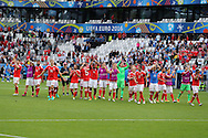 Wales players celebrate their win at the end of the match.  Euro 2016, Wales v Slovakia at Matmut Atlantique , Nouveau Stade de Bordeaux  in Bordeaux, France on Saturday 11th June 2016, pic by  Andrew Orchard,