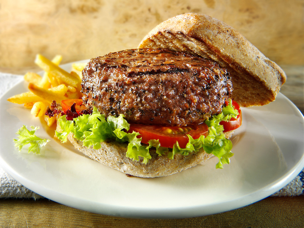beef burger  in a wholemeal bun with chips photos. Funky Stock Photos