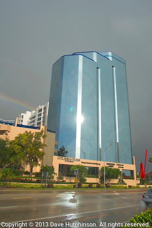 USA: Florida: Sarasota County: Sarasota: A rainbow appears over downtown Sarasota and behind One Sarasota Tower as the remnants of Tropical Storm Andrea depart the area.