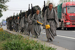 September 23, 2016 - Binzhou, Binzhou, China - Binzhou, CHINA-September 23 2016:?(EDITORIAL?USE?ONLY.?CHINA?OUT)  ..More than 30 nuns of Daoyuan Temple walk along road in Binzhou, east China¬°¬Øs Shandong Province, September 23rd, 2016. The nuns come from Daoyuan Temple in Haicheng, northeast China¬°¬Øs Liaoning Province.All of them only have one meal every day and don¬°¬Øt eat anything after noon. Meanwhile, they only sleep for four hours every day.They will start a 15-day hiking after Mid-Autumn Day every year. During their hiking, they keep walking with heavy package and just beg for food instead of money. According to precept of Buddhism, the nuns will never be involved with money in their life, neither will they save money. Therefore, they lead simple and abstemious life every day. (Credit Image: © SIPA Asia via ZUMA Wire)