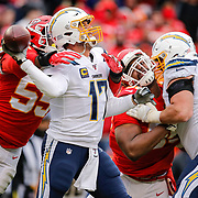 KANSAS CITY, MO - DECEMBER 29: Frank Clark #55 of the Kansas City Chiefs pressures Philip Rivers #17 of the Los Angeles Chargers on a third quarter pass at Arrowhead Stadium on December 29, 2019 in Kansas City, Missouri. (Photo by David Eulitt/Getty Images)