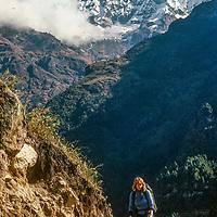 Meredith Wiltsie treks in the Khumbu Region of Nepal, with Mount Kusum Khangri in background.