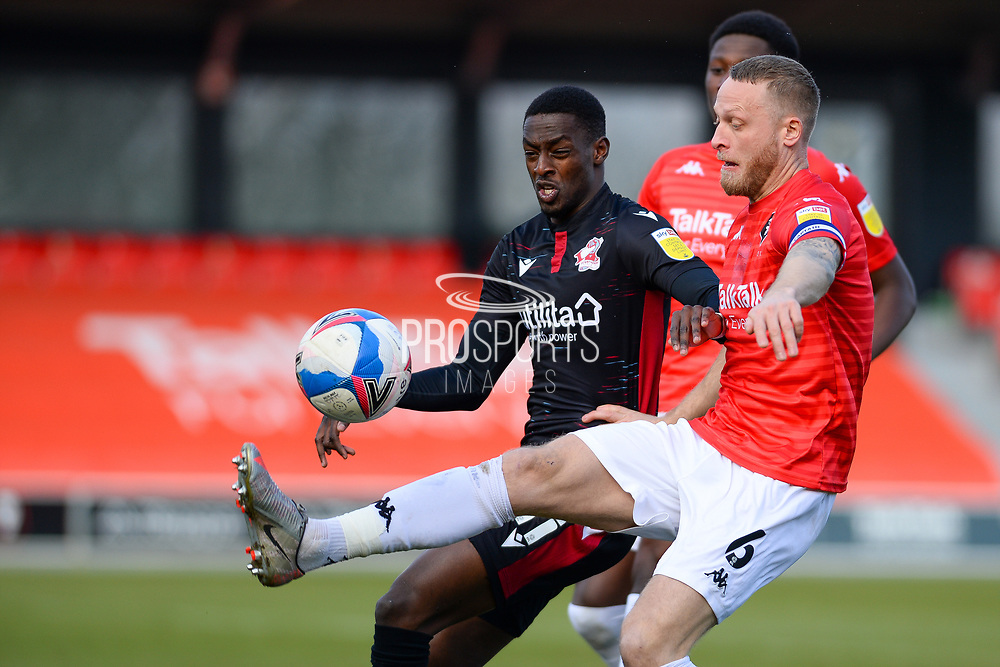 Salford City Tom Clarke (6) Scunthorpe United Abo Eisa (11) battles for possession during the EFL Sky Bet League 2 match between Salford City and Scunthorpe United at the Peninsula Stadium, Salford, United Kingdom on 6 March 2021.