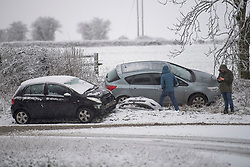 © Licensed to London News Pictures. 28/12/2020. Burford, UK. Two cars involved in an accident in heavy snow near the village of Burford in Oxfordshire, south England as the UK experiences freezing temperatures over night. Photo credit: Ben Cawthra/LNP