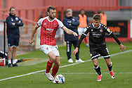 Archie Davies (15) of Crawley Town closes down Andy Williams (14) of Cheltenham Town during the EFL Sky Bet League 2 match between Cheltenham Town and Crawley Town at Jonny Rocks Stadium, Cheltenham, England on 10 October 2020.