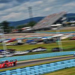 The GAINCO Auto Insurance/Bob Stallings Racing Corvette DP driven by Jon Fogarty and Alex Gurney races  the Sahlen's Six Hours of the Glen on June 30, 2013 at Watkins Glen International in Watkins Glen, New York.