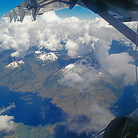 Tierra del Fuego, Chile. Twin Otter ski plane flies over wild mountains and fjords at southern tip of South America, en route to Antarctica.