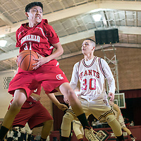 121714  Adron Gardner/Independent<br /> <br /> Bernalillo Spartan Zedrick Shorty (31), left, collects a rebound ahead of Grants Pirate Eric Rael  (30) during a Throwback matchup at Grants High School Wednesday.