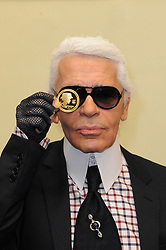 """German fashion designer Karl Lagerfeld presents a 5 Euro coin, designed by him, to commemorate the 125th anniversary of French fashion designer Gabrielle """"Coco"""" Chanel's birth at the Hotel de la Monnaie, the national mint responsible for making official coins and medals, in Paris, France on November 19, 2008. Photo by Ammar Abd Rabbo/ABACAPRESS.COM"""