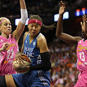 Seimone Augustus, (centre), Minnesota Lynx, drives to the basket defended by Katie Douglas, (left) and Chiney Ogwumike, Connecticut Sun, during the Connecticut Sun Vs Minnesota Lynx, WNBA regular season game at Mohegan Sun Arena, Uncasville, Connecticut, USA. 27th July 2014. Photo Tim Clayton