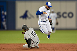March 29, 2018 - Toronto, ON, U.S. - TORONTO, ON - MARCH 29: Toronto Blue Jays Second base Devon Travis (29) completes a double play as New York Yankees Shortstop Didi Gregorius (18) slides unsuccessfully to second during the MLB season-opener game between the New York Yankees and the Toronto Blue Jays at Rogers Centre in Toronto, ON., Canada March 29, 2018. (Photo by Jeff Chevrier/Icon Sportswire) (Credit Image: © Jeff Chevrier/Icon SMI via ZUMA Press)