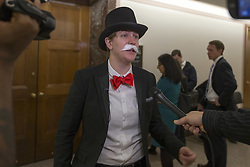 October 3, 2017 - Washington, District Of Columbia, USA - Members of the media interview a demonstrator outside a Senate Banking Committee hearing where United States Senators heard testimony from the Chief Executive Officer of Wells Fargo, Timothy Sloan. (Credit Image: © Alex Edelman via ZUMA Wire)