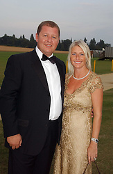 TONY & LESLEY PIDGLEY at the Cowdray Gold Cup Golden Jubilee Ball held at Cowdray Park Polo Club, on 21st July 2006.<br />