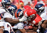 KANSAS CITY, MO - SEPTEMBER 28:   Jamaal Charles #25 of the Kansas City Chiefs is tackled by the defense of the Denver Broncos at Arrowhead Stadium on September 28, 2008 in Kansas City, Missouri.  The Chiefs defeated the Broncos 33-19.  (Photo by Wesley Hitt/Getty Images) *** Local Caption *** Jamaal Charles Sports photography by Wesley Hitt photography with images from the NFL, NCAA and Arkansas Razorbacks.  Hitt photography in based in Fayetteville, Arkansas where he shoots Commercial Photography, Editorial Photography, Advertising Photography, Stock Photography and People Photography