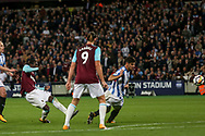 Pedro Obiang of West Ham (l) scores West Ham united's  first goal of the game . Premier league match, West Ham Utd v Huddersfield Town at the London Stadium, Queen Elizabeth Olympic Park in London on Monday 11th September 2017.<br /> pic by Kieran Clarke, Andrew Orchard sports photography.
