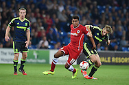 Tom Adeyemi of Cardiff city challenges Adam Clayton of Middlesbrough (r).Skybet football league championship match, Cardiff city v Middlesbrough at the Cardiff city stadium in Cardiff, South Wales on Tuesday 16th Sept 2014<br /> pic by Andrew Orchard, Andrew Orchard sports photography.