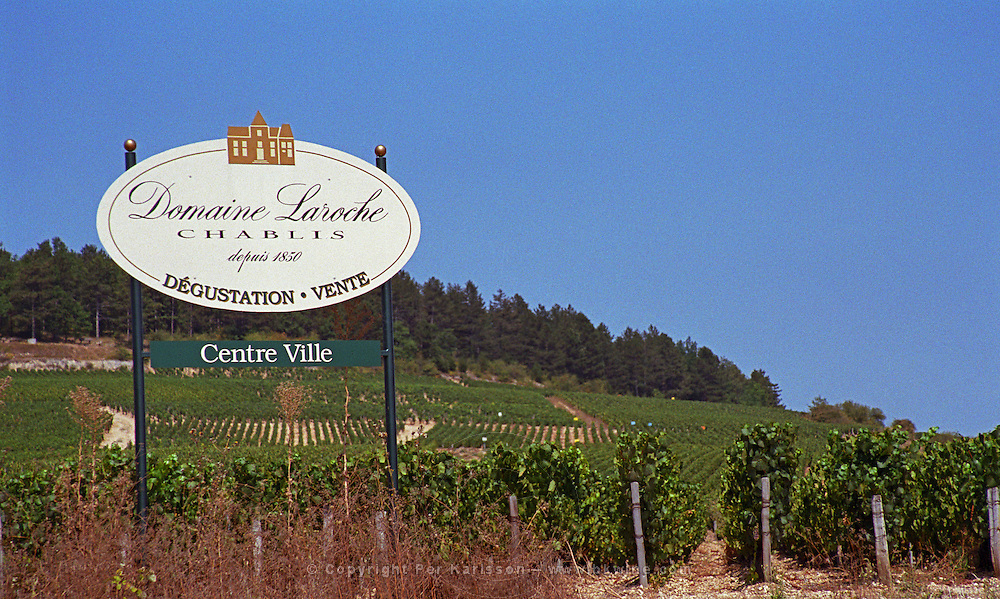 Chablis: sign for Domaine Laroche and the Les Clos Grand Cru vineyard in the back