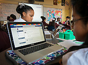 Students in Sarah Campbell's 7th-grade writing class use Edmodo as a portal to conducting their lessons at Young Women's College Preparatory Academy, October 15, 2013.