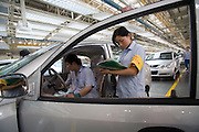 Factory workers inspect a car on the assembly line in the Chery Automobile factory in Wuhu, China, May 16, 2007. Chery Automobile, China's largest carmaker with a local brand, plans to build large sedans, shedding its image as an assembler of low-priced models to attract a growing number of drivers who can afford bigger cars.