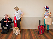 Tea Party supporters check their gift bags during registration for the Policy Summit in Phoenix, AZ, Friday. The Tea Party Patriots American Policy Summit starts in Phoenix Friday and goes through Sunday Feb. 27. About 2,000 people are expected to attend the event, which organizers said is meant to unite Tea Party groups across the country. Speakers include former Minnesota Governor Tim Pawlenty, Texas Congressman Ron Paul, former Clinton advisor Dick Morris and conservative blogger Andrew Brietbart. The event ends with a presidential straw poll Sunday.   Photo by Jack Kurtz