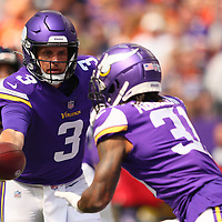 MINNEAPOLIS, MINNESOTA - AUGUST 14: Jake Browning #3 of the Minnesota Vikings hands off the ball to Ameer Abdullah #31 of the Minnesota Vikings in the first quarter of pre-season play against the Denver Broncos at U.S. Bank Stadium on August 14, 2021 in Minneapolis, Minnesota. (Photo by Adam Bettcher/Getty Images) *** Local Caption *** Jake Browning; Ameer Abdullah
