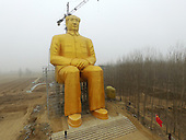 A huge statue of Mao Zedong appears