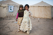 """Mcc0081437 . Daily Telegraph<br /> <br /> DT Foreign<br /> <br /> Children in an IDP camp on the outskirts of  Marib which receives aid from the King Salman Humanitarian Aid & Relief Centre . Many of the families have fled the Houthi rebel held capital city of Sanaa .<br /> <br /> Thanks to oil revenues and close ties with Saudi Arabia Marib could be viewed almost as an oasis of normalcy in a country torn apart by civil war . Since the conflict began in 2015 the town has expanded dramatically with Yemeni's flooding in from Houthi controlled areas attracted by the relative peace and stability .<br /> <br /> Yemen has been in the midst of a civil war since 2015 when the President Abdrabbuh Mansur Hadi was forced to flee . A Saudi led coalition with 9 other Arab states  named """"Operation Decisive Storm """"  has since sought to restore Hadi with little effect .<br /> <br /> Yemen 20 February"""