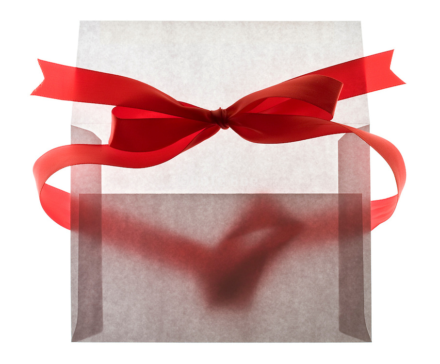 red bow ribbon around a envelope