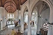 Nederland, Nijmegen, 17-4-2019 De Stevenskerk in het centrum van de stad met het beroemde Konig orgel heeft nieuwe, moderne ledverlichting gekregen via sponsoring en crowd funding. De armaturen zijn vervangen en het houten dak in tonconstructie is nu mooi uitgelicht te zien . Foto: Flip Franssen
