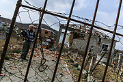 People appear to be distressed and in emotional pain, as they stand outside their property after a chain of massive explosions at an ammunition depot over the weekend killed 26 people and leave over 300 injured near the Tirana capital of Albania on Sunday, March 16, 2008. (Photo by Vudi Xhymshiti)