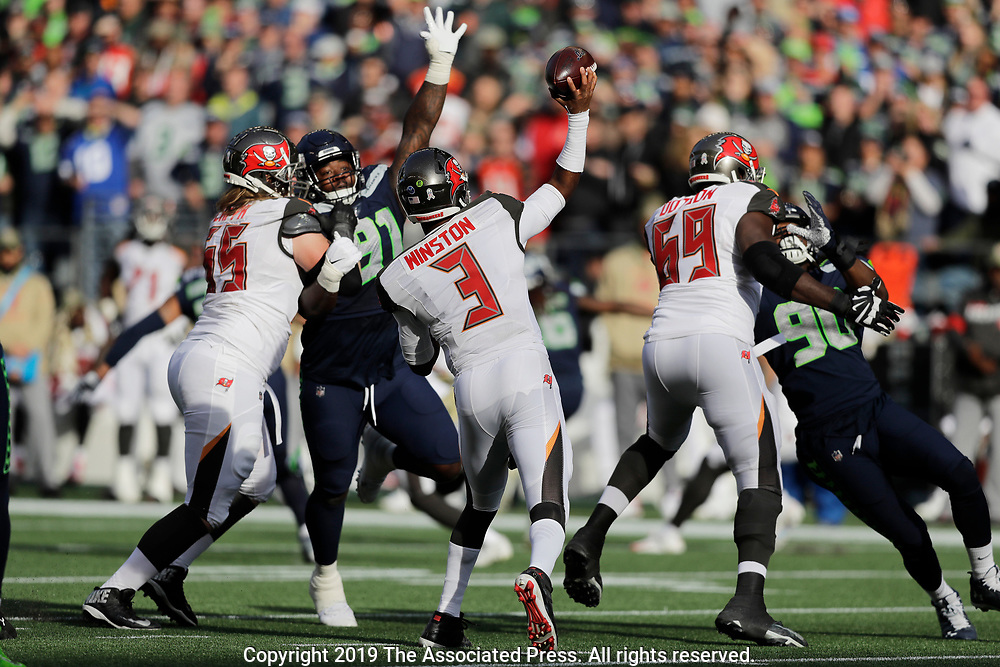 Tampa Bay Buccaneers quarterback Jameis Winston (3) passes against the Seattle Seahawks during the first half of an NFL football game, Sunday, Nov. 3, 2019, in Seattle. (AP Photo/John Froschauer)