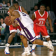 """2/11/06 -- Omaha, Ne.Omaha Central's Ronnell Grixby dribbles past Reserve Christian's Demond """"Tweety"""" Carter  (No.23) and The Omaha Shootout, a High School Basketball tournament featuring some of the best prospects at the Qwest Center Omaha...(Photo by Chris Machian/Prarie Pixel Group)."""