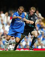 Photograph: Scott Heavey.<br />Chelsea v Leicester City, from Stamford Bridge. 23/08/2003.<br />Adrian Mutu battles with John Curtis.
