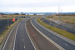 Edinburgh, Scotland, UK. 25 March, 2020. Day two of the Government enforced lockdown in the UK. All shops and restaurants and most workplaces remain closed. Cities are very quiet with vast majority of population staying indoors. Pictured; View of very quiet M90 motorway on approach to Queensferry Crossing Bridge. Iain Masterton/Alamy Live News