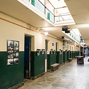 Original prison cell blocks are used as exhibit spaces for the Police and Penitentiary Museum that forms one part of the Maritime Museum of Ushuaia.