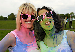 © Licensed to London News Pictures. 19/05/2013. Bristol, UK. Liz Clark (blonde) age 46 and Rebecca Marsh (dark hair) age 37, both from Bath, at the Rainbow Run for Children's Hospice South West on the Bristol Downs.  Runners start out clean and have multi-colour paint thrown on them, running in aid of CHSW's Charlton Farm hospice, one of three hospices in the South West dedicated to making the most of short and precious lives.  19 May 2013..Photo credit : Simon Chapman/LNP