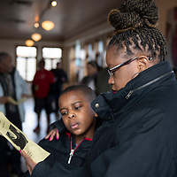 Monica Davis and her son Jarvis Vaughn, 9, at the interfaith prayer before the Martin Luther King Jr. march, Monday, Jan. 21 at the Gallup Cultural Center.