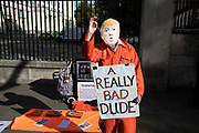 Guantanamo Justice Campaign protester dressed up as US President Donald Trump, a really bad dude, wearing an orange jumpsuit in London, United Kingdom. This protest on Whitehall was opposed to torture, cruelty, inhuman or degrading treatment and punishment of detainees on the US  base.