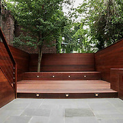 Ipe garden with blue stone paving and minimal planting by Outside Space NYC