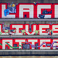 """A composite image of a """"Black Lives Matter"""" mural across the river from PNC Park,"""