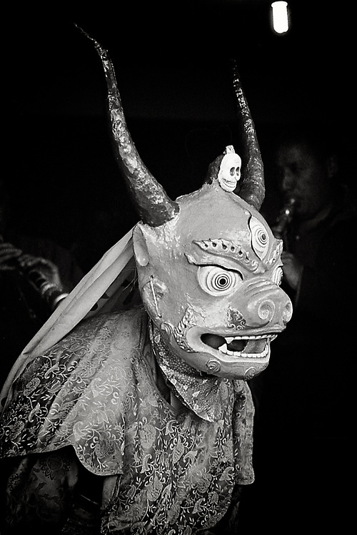 The ritual masks in Tibet are dressed by dancing monks on certain ceremonies to terrifiy evil spirits and to chase them off.  The more terrifying, the better they will keep spirits away and let the monk focus on meditation. <br /> Photo by Lorenz Berna