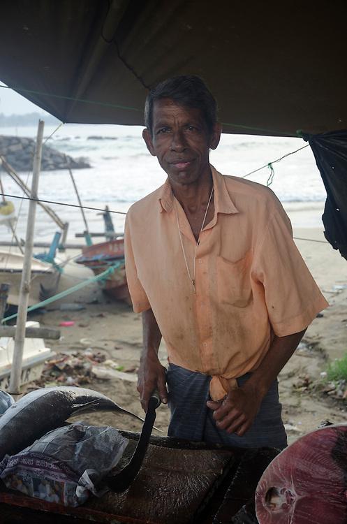 Fish vendor at Galle market, Sri Lanka