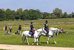 Licensed to London News Pictures. 30/05/2021. London, UK. Horse riders head out in the warm sunshine for a Sunday walk in Richmond Park, southwest London this afternoon. The Met Office have forecast warm weather and sunshine for the South East and London over the Bank Holiday weekend with temperatures predicted to hit up to 24c for Bank Holiday Monday. Photo credit: Alex Lentati/LNP