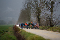 Peloton charge across sector 1 at Strade Bianche - Elite Women 2018 - a 136 km road race on March 3, 2018, starting and finishing in Siena, Italy. (Photo by Sean Robinson/Velofocus.com)