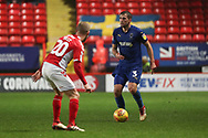 AFC Wimbledon defender Ben Purrington (3) taking on Charlton Athletic defender Chris Solly (20) during the EFL Sky Bet League 1 match between Charlton Athletic and AFC Wimbledon at The Valley, London, England on 15 December 2018.